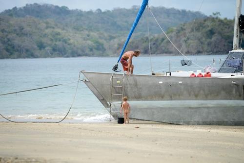 Beaching Sairam, the Wharram catamaran in Las Perlas, Panama.
