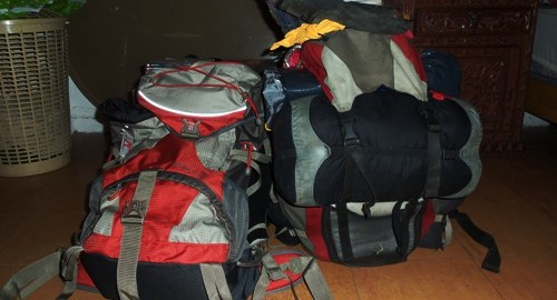 Two hitchikers' backpacks ready to go.