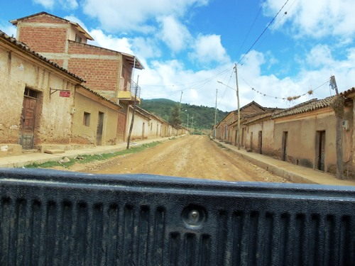 Hitchhiking in the back of a pick-up truck in Bolivia.