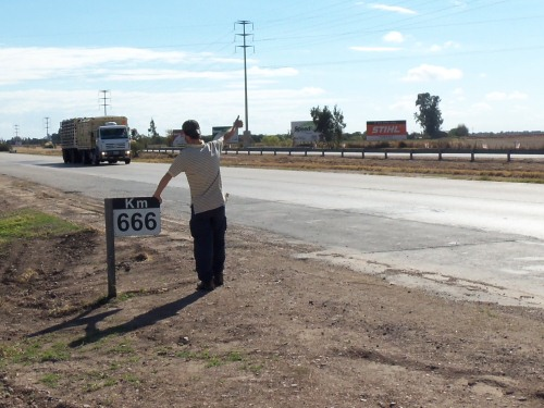 Hitchhiking at mile 666 in Argentina.