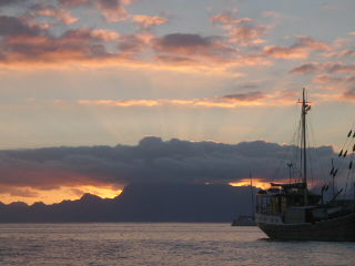 The last rays of sun shooting above Moorea as seen from Tahiti.
