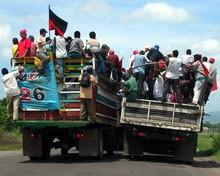 Crowded trucks in Nicaragua.