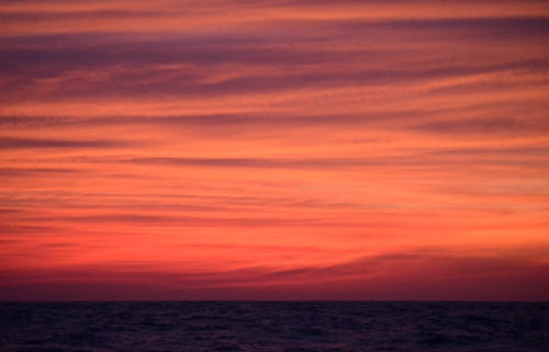 The aforementioned sunset over the Pacific ocean swell.