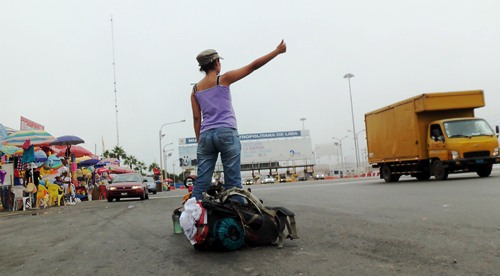 Mayra hitchhiking in Peru leaving Lima.