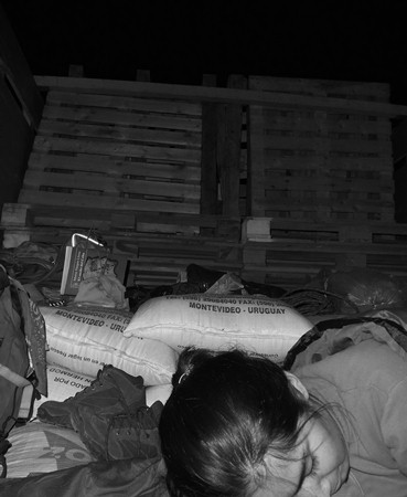 Mayra sleeping in the trailer somewhere on the roads of Peru.