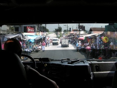 Arriving in a truck to a San Salvador market.
