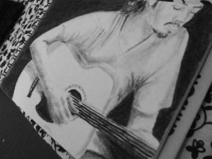Guitarist drawing in Cordoba, Argentina
