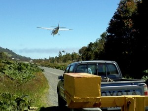 A plane landing on the road in front of us on the Carretera Austral.