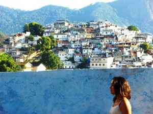 A favela hill town in Rio de Janeiro, Mayra walking in front.